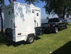 A Small two-stall restroom trailer is the perfect size for a small outdoor party or event