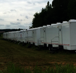 Restroom and Shower Trailers Lined Up Outside