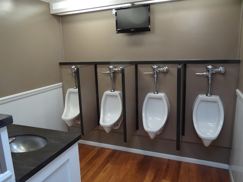 Interior View of Urinal Stalls in Restroom Trailer