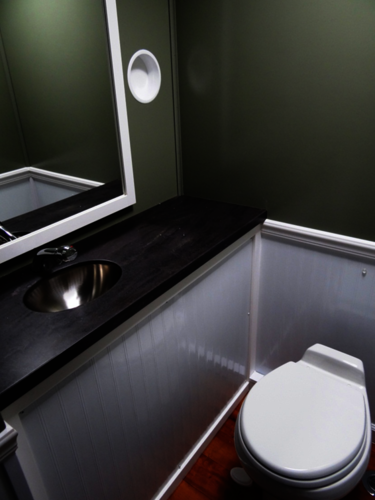 Interior View of Grand Luxury 3-Station Restroom Trailer Toilet and Sink