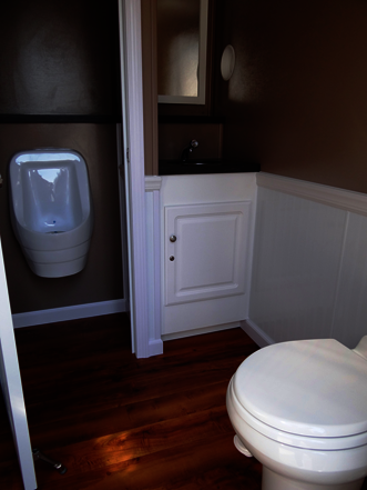 Interior View of Grand Luxury 3-Station Restroom Trailer Urinal and Toilet