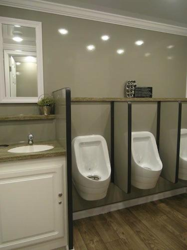 Urinals & stalls in the men's room