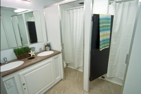 Showers and sinks both have fully function hot and cold running water
