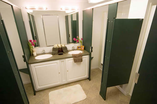 Each shower in our shower trailer has its own private stall and dressing area